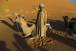 December 10, 2015 - Merzouga, Meknès-Tafilalet, Morocco - Camel driver with his camels in the Erg Chebbi sand dunes (Credit Image: © Dani Salv/VW Pics via ZUMA Wire)