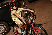 Israel, Tel Aviv, Children ride their bikes in the deserted streets on Yom Kippur