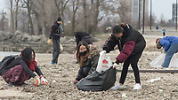"The Jackson Park Advisory Council celebrated Earth Day Saturday afternoon, April 21st, 2018 with a clean up of 57th Street Beach. Volunteers from all over the city came to help.<br /> <br /> 7322 - University of Chicago students, Tina Jhang, Sunny Liu and Rachel Shang collect garbage off the beach.<br /> <br /> Please 'Like' ""Spencer Bibbs Photography"" on Facebook.<br /> <br /> Please leave a review for Spencer Bibbs Photography on Yelp.<br /> <br /> Please check me out on Twitter under Spencer Bibbs Photography.<br /> <br /> All rights to this photo are owned by Spencer Bibbs of Spencer Bibbs Photography and may only be used in any way shape or form, whole or in part with written permission by the owner of the photo, Spencer Bibbs.<br /> <br /> For all of your photography needs, please contact Spencer Bibbs at 773-895-4744. I can also be reached in the following ways:<br /> <br /> Website – www.spbdigitalconcepts.photoshelter.com<br /> <br /> Text - Text ""Spencer Bibbs"" to 72727<br /> <br /> Email – spencerbibbsphotography@yahoo.com"