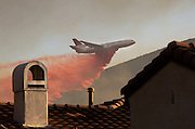 San Marcos, California, U.S. - <br /> <br /> California Wildfires 2014 - Cocos Fire<br /> <br /> A DC-10 air tanker dumps a load of fire retardant on the burning hills of San Marcos. The hills behind Cal State San Marcos burn as structures caught fire and others were threatened, north of San Diego.<br /> ©Exclusivepix