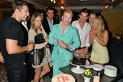 HENRY CONWAY and friends at Henry Conway's 31st birthday party held at the Pont St Restaurant, Belgraves Hotel, London on 12th July 2014.