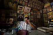 Mr. K. Moorthy on the phone in his studio in Nagore.