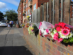 © Licensed to London News Pictures. 08/08/2018. London, UK. Flowers are left at the scene of a house fire in Deptford, south London, in which a 7-year-old boy died. Police are treating the incident as arson and a murder inquiry has been launched. Photo credit: Rob Pinney/LNP