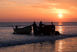 © Licensed to London News Pictures. <br /> 24/04/2015. <br /> <br /> Saltburn, United Kingdom<br /> <br /> The fishing boat Senna is launched from the beach at Saltburn before heading out to fish for cod.<br /> <br /> <br /> Photo credit : Ian Forsyth/LNP