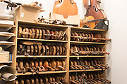 Shelves of old violins waiting to be salvaged for parts or restored at The North Bennett Street School, Boston5