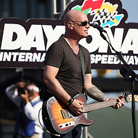 Jim Stafford of the Grammy award winning band Train during a one hour performance prior to the start of the NASCAR Coke Zero 400 race at Daytona International Speedway in Daytona Beach, Fl., on Saturday July 7, 2012. (AP Photo/Alex Menendez)