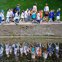 Children Walking in Row at Palace Park in Oslo, Norway <br />