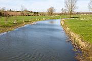 River Waveney at near bankfull condition looking east at Mendham, Suffolk and Norfolk border, England, UK
