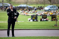 © licensed to London News Pictures. Stafford, UK  17/03/2012. The funeral of PC David Rathband. A mourning policeman wipes away a tear as the funeral is relayed via speakers, outside Stafford Crematorium. Photo credit should read Joel Goodman/LNP
