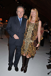 SIR DAVID & LADY CARINA FROST at a dinner hosted by Cartier following the following the opening of the Chelsea Flower Show 2012 held at Battersea Power Station, London on 21st May 2012.