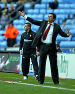 Coventry - Saturday, March 8th, 2008: Coventry City's manager Chris Coleman shouts instructions as former teammate and player, Lee Clark, assistant manager of Norwich City looks on during the Coca Cola Championship match at the Ricoh Arena, Coventry. (Pic by Paul Hollands/Focus Images)