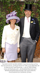 The HON.HARRY & MRS HERBERT, he is the brother of the Earl of Carnarvon, at Royal Ascot on 18th June 2002.	PBC 59