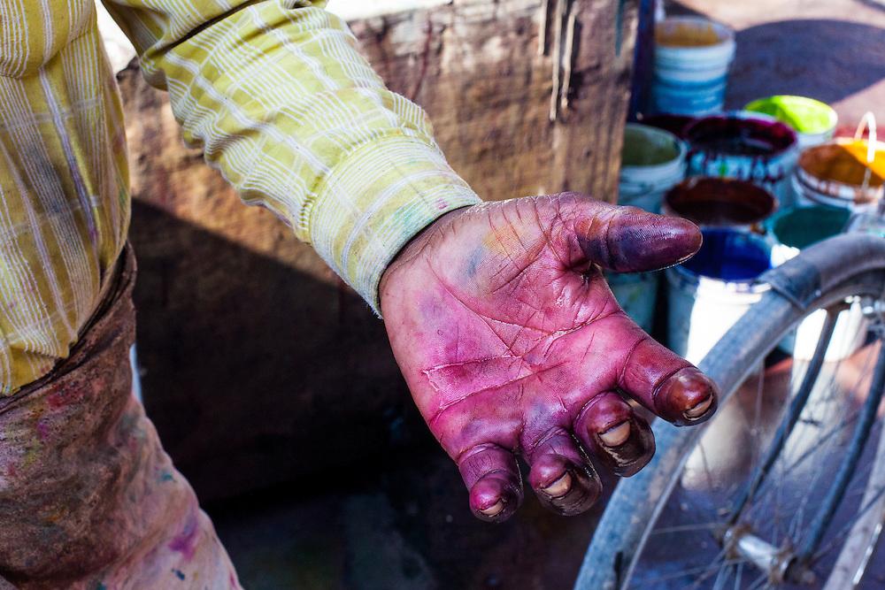 The dye mixers hands.