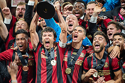 December 8, 2018 - Atlanta, Georgia, United States - Atlanta United defender and captain MICHAEL PARKHURST (3) lifts the MLS Cup with teammates at Mercedes-Benz Stadium in Atlanta, Georgia.  Atlanta United defeats Portland Timbers 2-0 (Credit Image: © Mark Smith/ZUMA Wire)