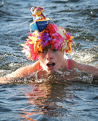 (c) Licenced to London News Pictures 31/01/2015. Low Wood Bay Marina, Windermere, Cumbria, UK. Chill Swim 2015 in Windermere. Outdoor swimming event with no wetsuits allowed. Water temperature is around 5 degrees. Photo credit : Harry Atkinson/LNP