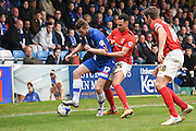 Gillingham forward Rory Donnelly keeps possession under pressure from Coventry midfielder Jacob Murphy during the Sky Bet League 1 match between Gillingham and Coventry City at the MEMS Priestfield Stadium, Gillingham, England on 2 April 2016. Photo by David Charbit.