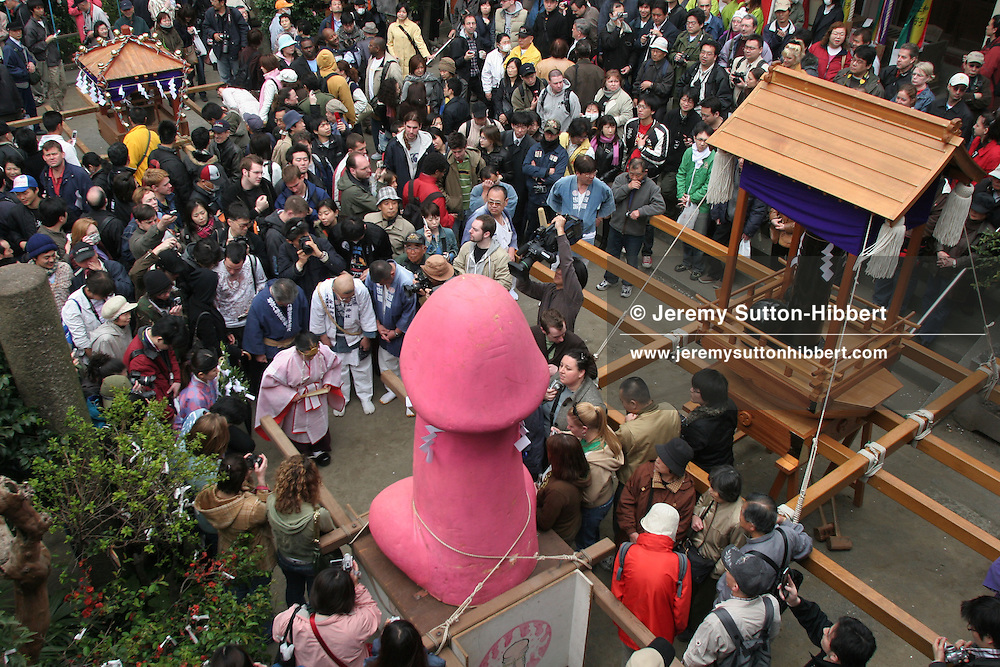 The Kanamara Matsuri (Festival of the Steel Phallus), takes place amidst large crowds at Wakamiya Hachiman-gu shrine in Kawasaki, Japan, on Sunday, Apr. 2nd 2006. The festival dates back to the Edo period (1603-1867) when the prostitutes of Kawasaki's prayed for good business, and for protection from syphilis. Now the festival offers people a place to pray for protection from all types of sexually transmitted diseases, including HIV/AIDS.