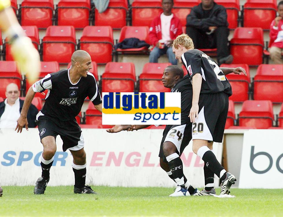 Photo: Chris Ratcliffe.<br />Leyton Orient v Swansea City. Coca Cola League 1. 26/08/2006.<br />Leon Knight (centre) of Swansea celebrates scoring the first goal with team mates Darren Pratley (L) and Shaun Macdonald (R).