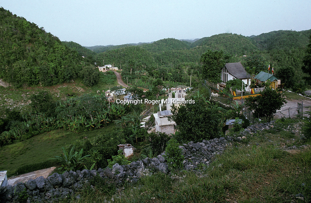 The valley of Nine Miles in St. Ann, Jamaica, birthplace and boyhood home of Reggae superstar Bob Marley, July 1991. His birthplace and burial crypt compound can be seen at right. Bob Marley died of cancer in a Miami hospital at the age of 36 on May 11, 1981. (Photo by Roger M. Richards)