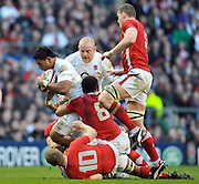 Twickenham, GREAT BRITAIN, England's,  Manusamoa TUILAGI,  drags there Welsh players' along with the fourth moving in to tackle,  during the 2012 Six Nations match, England vs Wales. Played at the RFU Stadium Twickenham, Surrey on Saturday  25/02/2012.  [Photo. Peter Spurrier/Intersport-images]