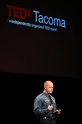 """Charles """"Chip"""" Huth speaking at TEDx Tacoma on Saturday, March 21, 2015. (Photo: John Froschauer/PLU)"""