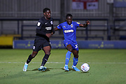 AFC Wimbledon defender Paul Osew (37) battles for possession with Brighton and Hove Albion striker Taylor Richards (45) during the EFL Trophy (Leasing.com) match between AFC Wimbledon and U23 Brighton and Hove Albion at the Cherry Red Records Stadium, Kingston, England on 3 September 2019.