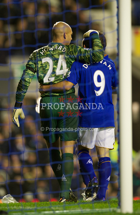 LIVERPOOL, ENGLAND - Wednesday, January 4, 2012: Everton's goalscorer goalkeeper Tim Howard is congratulated by his American compatriot Landon Donovan against Bolton Wanderers during the Premiership match at Goodison Park. (Pic by David Rawcliffe/Propaganda)