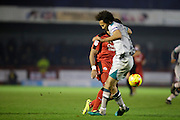 Josh Growling intercepts Andre Blackman during the EFL Sky Bet League 2 match between Crawley Town and Grimsby Town FC at the Checkatrade.com Stadium, Crawley, England on 26 November 2016. Photo by Jarrod Moore.