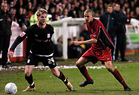Photo: Leigh Quinnell.<br /> Tamworth v Stoke City. The FA Cup. 17/01/2006. Stokes Paul Gallagher looks for the pass but is watched by Tamworths  Nick Wright.