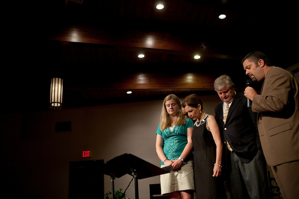 Republican presidential hopeful Michele Bachmann, along with daughter Sophia Bachmann and husband Marcus Bachmann (2nd R) campaigns on Sunday, July 24, 2011 in Marion, IA.