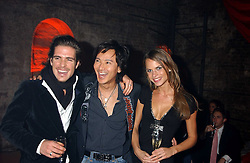 Left to right, PATRICK MEAHAN, ANDY WONG and NATALIE BOMGREM at a party for De Beers to celebrate the launch of their Rough diamond ÔTalisman Collection' held at Shunt Vaults, London Bridge, London SE1 on 28th November 2005.<br /><br />NON EXCLUSIVE - WORLD RIGHTS