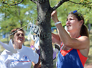 From left, Judi Reiss and Tara Bane hang 4,000 paper doves -- 2,977 to represent each of the people who died on 9/11, Wednesday September 7, 2016 at the Garden of Reflection in Lower Makefield, Pennsylvania. (Photo by William Thomas Cain)