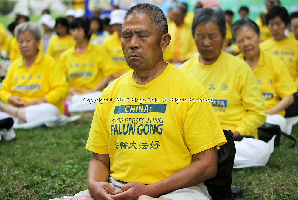 Thousands Falun Gong practitioners meditate on the south lawn of Los Angeles City Hall to show their support for the global lawsuit action against Chinas former President Jiang Zemin (1993-2003), who is being sued for crimes including genocide and torture, October 15, 2015 in Los Angeles, California.<br /> (Photo by Ringo Chiu/PHOTOFORMULA.com)