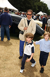 """LORD LINLEY and his son the HON.CHARLES ARMSTRONG-JONES at the Goodwood Festival of Speed on 9th July 2006.  Cartier sponsored the """"Style Et Luxe' for vintage cars on the final day of this annual event at Goodwood House, West Sussex and hosted a lunch.<br /><br />NON EXCLUSIVE - WORLD RIGHTS"""