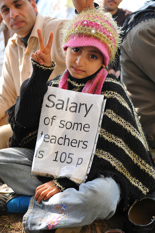 A nine-year-old girl from Fayoum, two hours south of Cairo, is among those who protested in downtown Cairo for change in Egypt. Her father is in the background. (Cairo, Egypt - February 9, 2011)