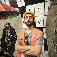 """Nella fotografia: Simone Fugazzotto street artist milanese CHIOMONTE (TORINO) -10 ottobre 2016 - inaugurazione di """"Tunnel Art Work"""", primo progetto internazionale di arte nella galleria geognostica in cantiere della linea ferroviaria Tav Torino Lione."""