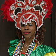 Brazilian pride, Bahiana performer /  dancer in traditional folk costume and headpiece and  adorned by numerous colorful beads, bracelets, necklaces.