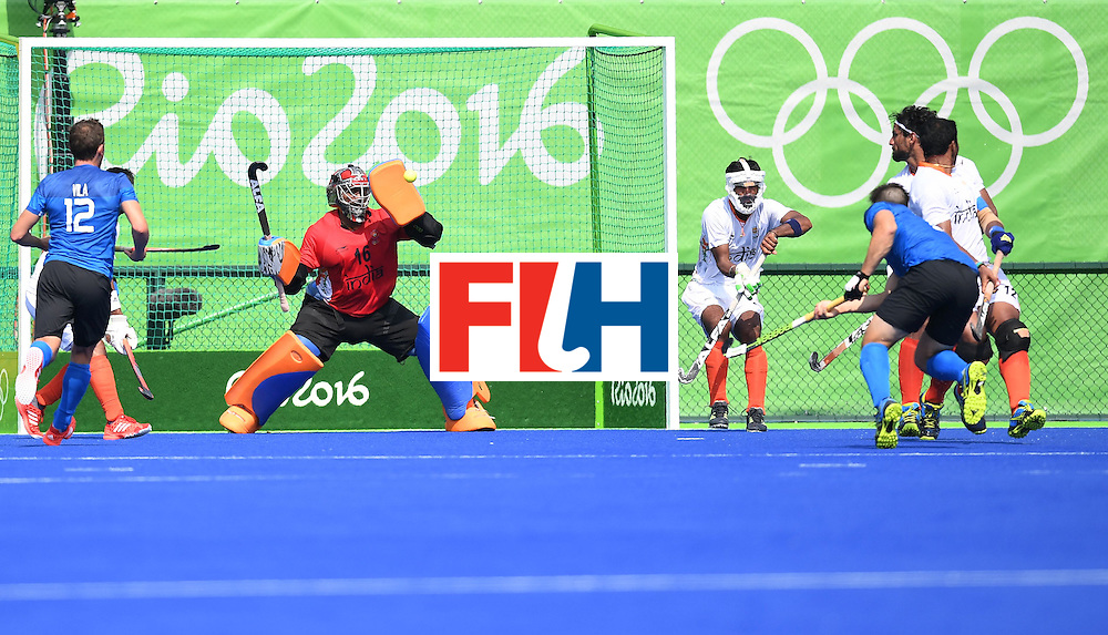 India's Sreejesh Parattu (C) stops a shot on goal during the men's field hockey Argentina vs India match of the Rio 2016 Olympics Games at the Olympic Hockey Centre in Rio de Janeiro on August, 9 2016. / AFP / MANAN VATSYAYANA        (Photo credit should read MANAN VATSYAYANA/AFP/Getty Images)
