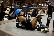 Kiki Diazz falls during a bout. The San Diego Derby Dolls skated to victory, beating the Mitten Kittens of Michigan 193-58 in their first home bout on their new banked track.