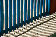 Balustrade in Blue. Shadows on old wood.<br /> Thittacheri town.<br /> Tamil Nadu. South India.
