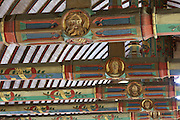 Beams painted with the motto of Nicolas Rolin, Seule and a star, and faces of local people, architectural detail of the painted wooden ceiling in the shape of a boat's hull, in the Salle des Povres or Room of the Poor, almost 50m long, in Les Hospices de Beaune, or Hotel-Dieu de Beaune, a charitable almshouse and hospital for the poor, built 1443-57 by Flemish architect Jacques Wiscrer, and founded by Nicolas Rolin, chancellor of Burgundy, and his wife Guigone de Salins, in Beaune, Cote d'Or, Burgundy, France. The hospital was run by the nuns of the order of Les Soeurs Hospitalieres de Beaune, and remained a hospital until the 1970s. The building now houses the Musee de l'Histoire de la Medecine, or Museum of the History of Medicine, and is listed as a historic monument. Picture by Manuel Cohen