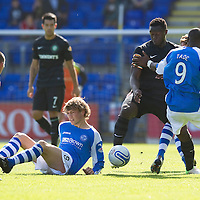 St Johnstone v Celtic....15.09.12      SPL  <br /> Gregory Tade and Murray Davidson battle with Victor Wanyama and Scott Brown<br /> Picture by Graeme Hart.<br /> Copyright Perthshire Picture Agency<br /> Tel: 01738 623350  Mobile: 07990 594431