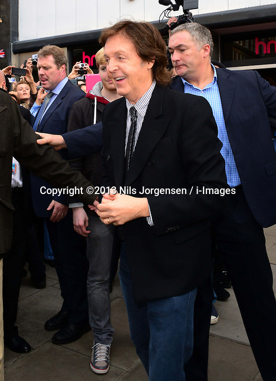 Sir Paul McCartney album signing.<br /> The most successful songwriter in UK singles chart history leaving HMV Oxford Street where he hosted meet and greet with fans as he signs copies of his first solo album of original songs since 2007, HMV, Oxford Street London, United Kingdom. Friday, 18th October 2013. Picture by Nils Jorgensen / i-Images