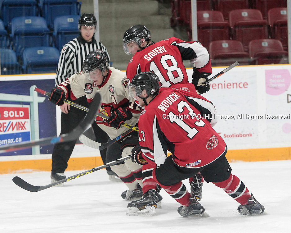 TRENTON, ON  - JAN 23,  2017: Ontario Junior Hockey League game between the Stuoffville Spirit and the Newmarket Hurricanes at the 2017 Winter Showcase. The battle for the puck. <br /> (Photo by Tim Bates / OJHL Images)