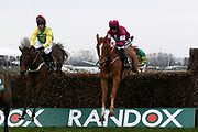 Winner Finiazns Oscar (Green & Yellow) and Robbie Power and second placed  Calino D'Airy with Sean Flanagan in The Betway Bowl Steeple Chase  at Aintree, Liverpool, United Kingdom on 12 April 2018. Picture by Craig Galloway.