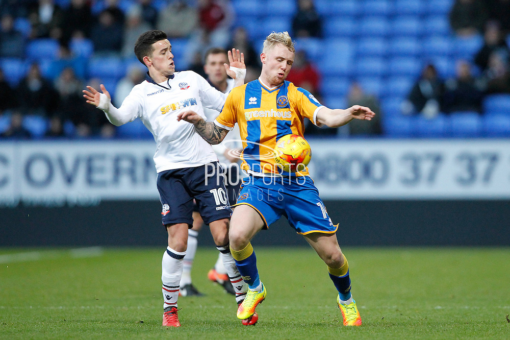 Bolton's Zach Clough (10) and Shrewsbury's Jack Grimmer (14) during the EFL Sky Bet League 1 match between Bolton Wanderers and Shrewsbury Town at the Macron Stadium, Bolton, England on 26 December 2016. Photo by Craig Galloway.
