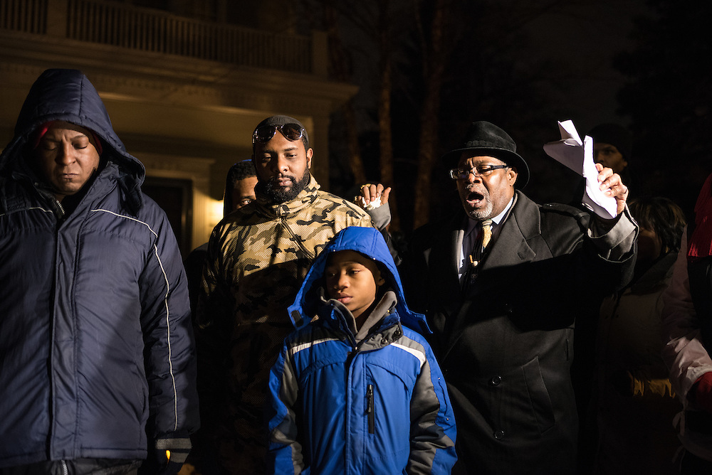 H. Demetrius Bonner leads a prayer for victims of gun violence outside Mayor Emanuel's house on December 21, 2016.