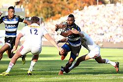 Anthony Watson of Bath Rugby is tackled- Mandatory byline: Robbie Stephenson/JMP - 07966386802 - 31/10/2015 - RUGBY - Recreation Ground -Bath,England - Bath Rugby v Harlequins - Aviva Premiership