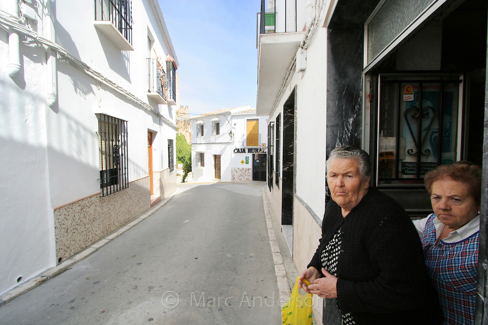 Two old ladies shopping in Zuheros, a Spanish white village in Andalucia, Spain