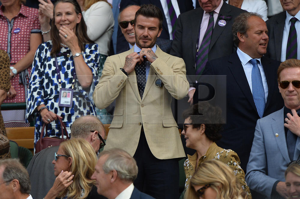 © Licensed to London News Pictures. 12/07/2019. London, UK. David Beckham watches centre court tennis in the royal box on Day 11 of the Wimbledon Tennis Championships 2019 held at the All England Lawn Tennis and Croquet Club. Photo credit: Ray Tang/LNP